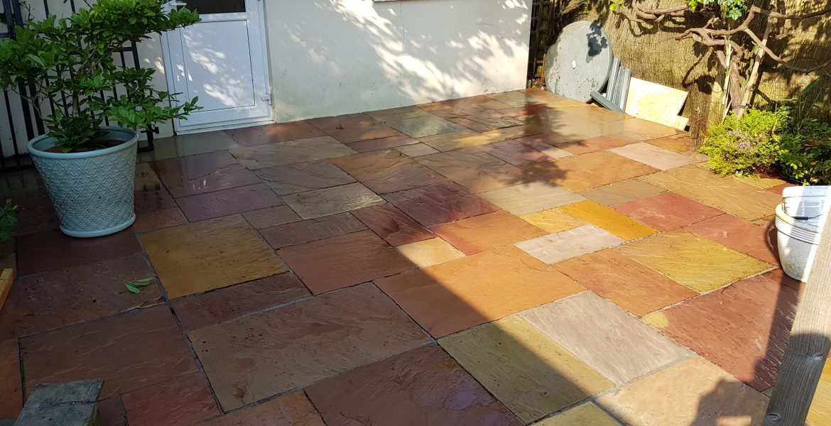 Indian sandstone patio cleaned with a pressure washer